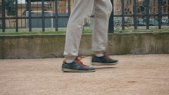 Young student teenager boy's legs in grey sports trousers and sport sneakers Stock Footage