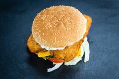 Fish Burger on a slate slab Stock Photos