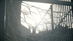 Sun is shining though soccer gates or net at the abandoned empty football field Stock Footage