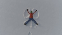 Making snow angels Stock Footage