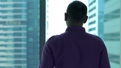 Successful businessman admire view from window at home Stock Footage