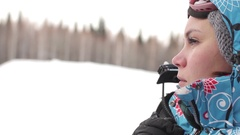 Woman in a Ski Suit Rises on a Lift in the Mountains Stock Footage