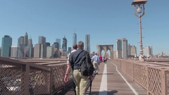 HYPERLAPSE: Tourists crossing Brooklyn Bridge, taking pictures and hanging out Stock Footage