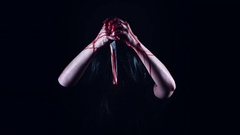 4K Horror Creepy Woman Holding Knife with Blood Stock Footage
