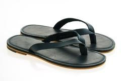 Leather shoes and sandal Stock Photos