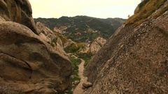 A road into a gorge in the mountains. Aerial. About rocky, nature, trees, volcan Stock Footage