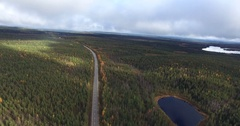 Cinema 4k 360 degree aerial view above a road in finnish national forrests .. Stock Footage