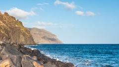 Ocean, blue water waves crashing on rocks. Timelapse Stock Footage