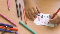 Kid draws the image using the felt pens. Close-up Stock Footage