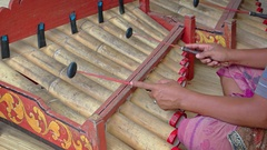 Local musicians play traditional, bamboo percussion pipes in Bali, Indonesia Stock Footage