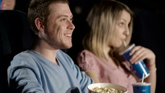 Handsome Man Shushing at the Movie Theatre Stock Footage