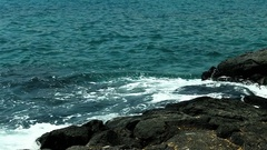Tropical Sea Water Surging Up On Black Lava Rock Shore Stock Footage