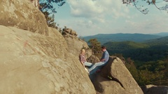 Young hikers holding their hands on top of the mountain peak. Outside shooting Stock Footage
