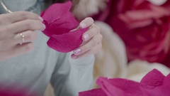 Designer wedding ceremonies and parties making a giant paper flower Stock Footage
