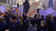 Protesters Shout, Hold Political Protest Signs and Peacefully March Past Grand Stock Footage
