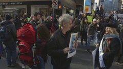 A Man Holds a Political Protest Sign During The 