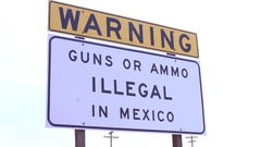 Warning Sign Stating that Guns and Ammo are Illegal to bring into Mexico. Stock Footage