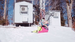 Few shots of playful young people falling down in the snow, whirling, laughing Stock Footage