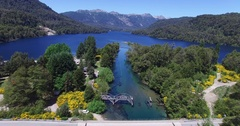 Aerial scene, river and lake, yellow plants camera going down to old bridge Stock Footage
