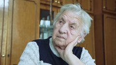 Portrait of old wrinkled tired alone grandmother looking at camera. 4k Stock Footage