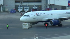 Delta Airlines plane departure, airport tug push back Stock Footage