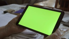 A blank tablet PC in landscape orientation with a green screenin hands. 4k Stock Footage