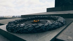 Eternal fire on the memorial of soldiers being killed on the World War II Stock Footage