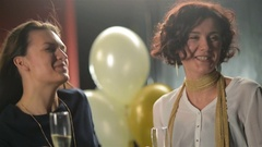 Two Cheerful Women are Celebrating Something in the Club. Party Girls Enjoying Stock Footage