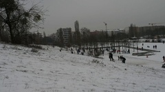 Germany, Berlin, skating on the snow in the Mauerpark,  January 8, 2017 Stock Footage