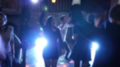 Nightclub clubbers with hands in air and light camera blur Stock Footage