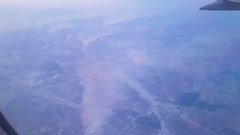 View from flying plane at dawn on the snow-covered land and forests. Pollution Stock Footage