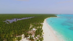 Incredibly beautiful island with white sand beaches, palm trees and crystal blue Stock Footage
