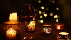 NeverEnding wine pouring seamless footage with christmas tree background Stock Footage