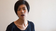 Short hair Asian woman upset. Taking sunglasses of and point angry expression Stock Footage