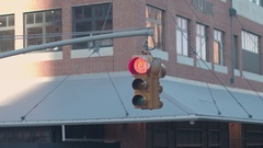 CLOSE UP: Unique New York City yellow hanging traffic light at road intersection Stock Footage