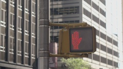 CLOSE UP: Pedestrian traffic lights raised hand pictogram signaling don't walk Stock Footage