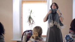 Fashion specialist teaches how to tie an oblong thick winter scarf Stock Footage