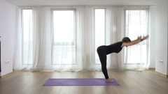 Young slim blonde woman practicing and teaching yoga exercises in studio Stock Footage