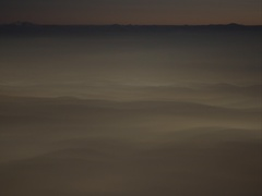 Mist moving over the valley before dawn timelapse Stock Footage