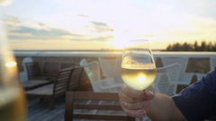 Group of people toasting and drinking wine on the restaurant terrace over sunset Stock Footage