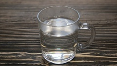 Boiled water in a glass cup.Full hd video Stock Footage