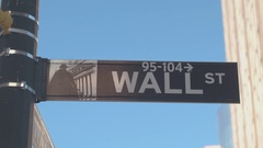 CLOSE UP: Iconic Wall Street sign in Lower Manhattan New York financial district Stock Footage