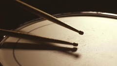 Two drum sticks hitting a snare drum Stock Footage