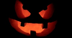 Closeup of Scary Holiday Halloween Carved Glowing Pumpkins. Jack-O-Lantern Stock Footage