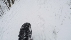 Cycling in the winter forest. Action camera shot. Type front wheel. Stock Footage