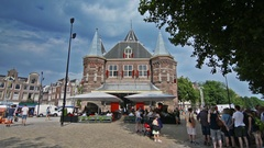 People in outdoor cafe on Nieuwmarkt (New Market) square in center of Amsterdam Stock Footage