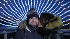 Happy romantic couple embracing at Valentines day in a evening city street. Slow Stock Footage