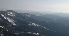 Mountain Ridge and Snow Covered Mountains. Pan View Stock Footage