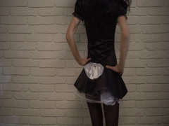 Sexy French maid flirting. The girl in a maid costume in front of camera Stock Footage