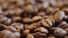 Roasted coffee beans on a table. Rotating. Close up Stock Footage